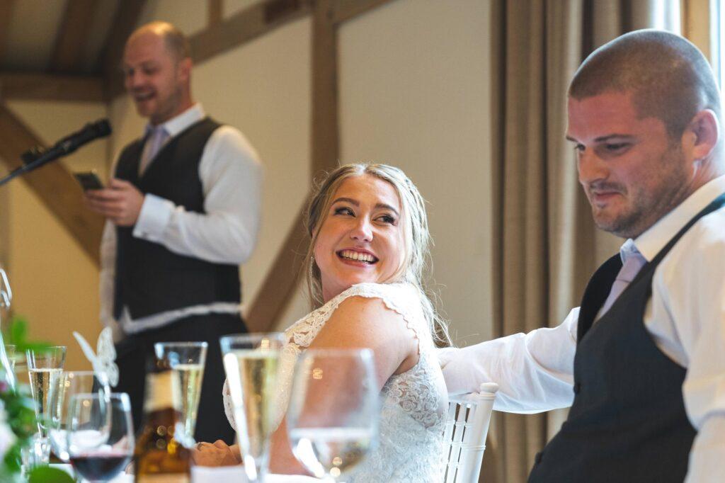 bride groom hear best man speech cain manor reception surrey oxfordshire wedding photographer