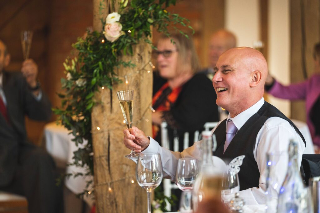 guests champagne toast cain manor reception hamshire surrey borders oxford wedding photographer