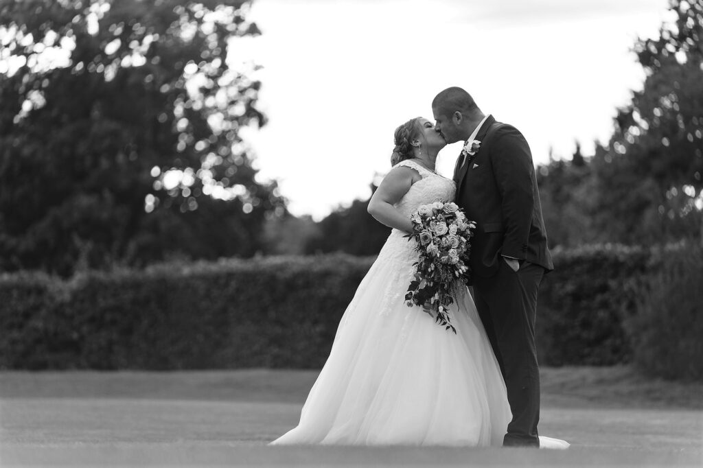 bride groom evening kiss cain manor grounds hampshire surrey borders oxford wedding photography