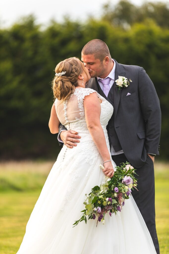 groom embraces bride cain manor hampshire surrey borders oxford wedding photographers