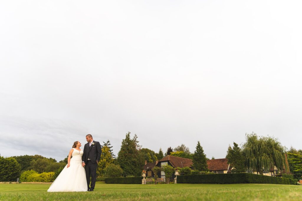 bride groom stroll grounds holding hands cain manor surrey oxford wedding photography
