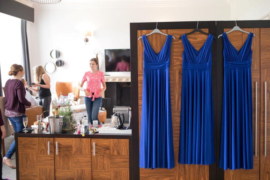 bridesmaids blue dresses bridal prep de vere beaumont hotel windsor oxfordshire wedding photographers