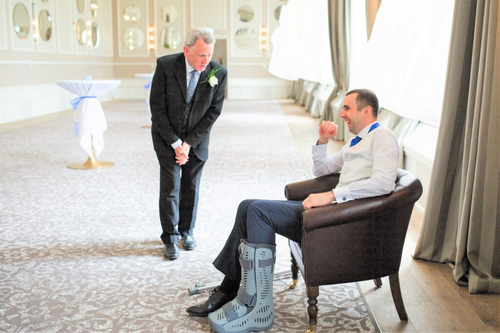 grooms plaster leg cast de vere beaumont hotel windsor oxford wedding photographers