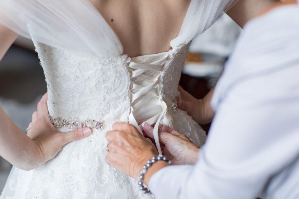 brides dress laceup bridal preparation de vere beaumont hotel windsor oxfordshire wedding photographers