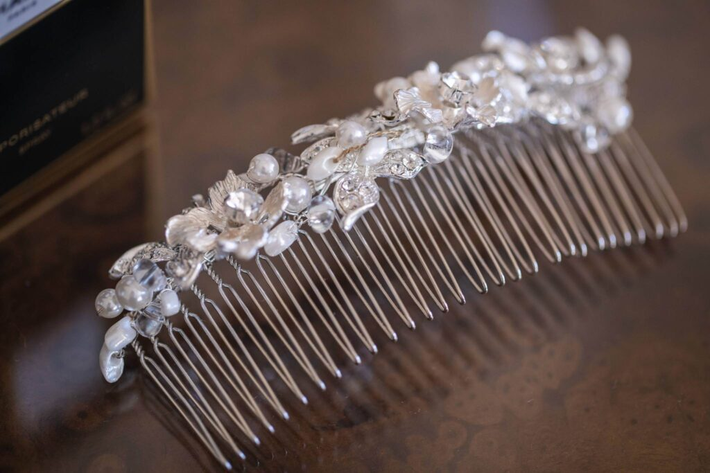 brides pearl hair ornament bridal prep hanbury manor ware hertfordshire oxfordshire wedding photographer