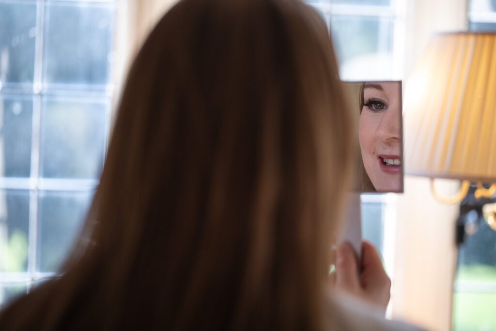 brides makeup mirror reflection bridal prep hanbury manor ware hertfordshire oxford wedding photographer