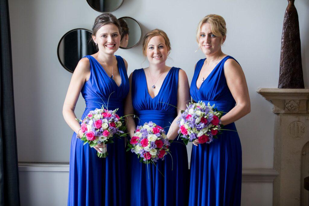 bridesmaids blue dresses with bouquets de vere beaumont hotel windsor oxfordshire wedding photography