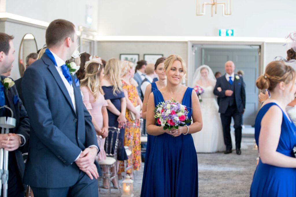 bride enters marriage ceremony de vere beaumont hotel windsor oxfordshire wedding photographers