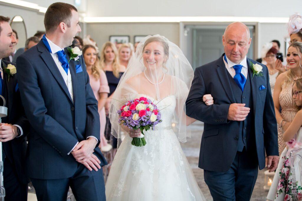 groom greets bride marriage ceremony de vere beaumont hotel windsor oxford wedding photographer