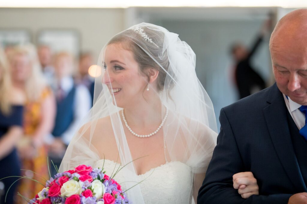 father of bride smiling bride marriage ceremony de vere beaumont hotel windsor oxford wedding photographers