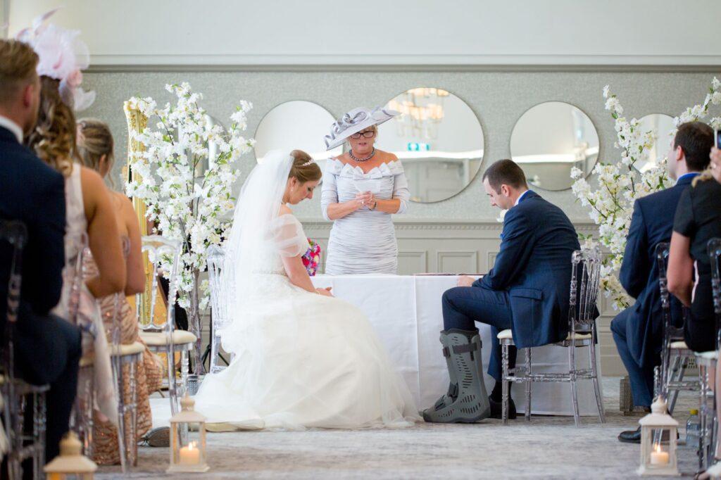 bride groom hear prayer marriage ceremony de vere beaumont hotel windsor oxford wedding photography