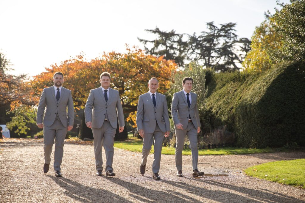 groom groomsmen stroll hanbury manor grounds ware hertfordshire oxford wedding photography
