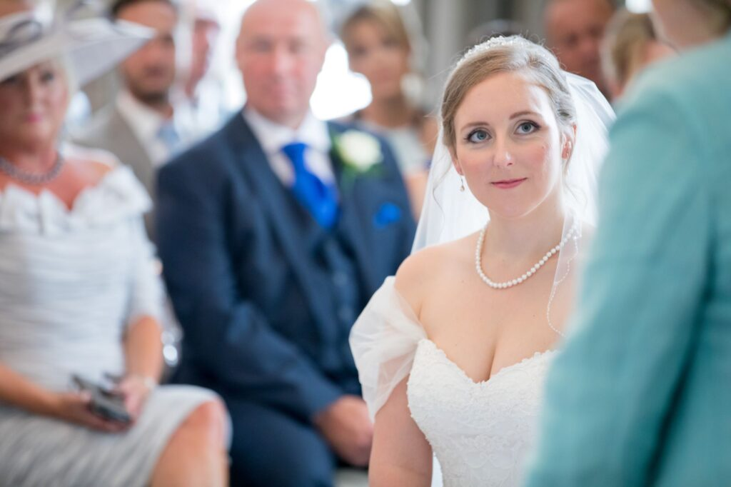 bride listens to celebrant marriage ceremony de vere beaumont hotel windsor oxfordshire wedding photographers