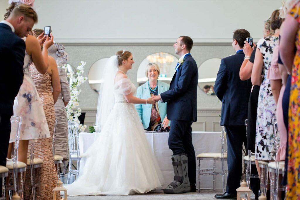 bride groom exchange vows marriage ceremony de vere beaumont hotel windsor oxfordshire wedding photography