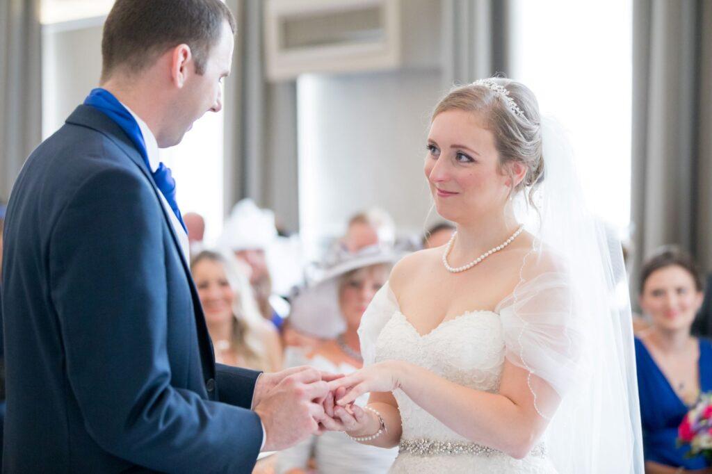bride groom exchange rings marriage ceremony de vere beaumont hotel windsor oxford wedding photographer
