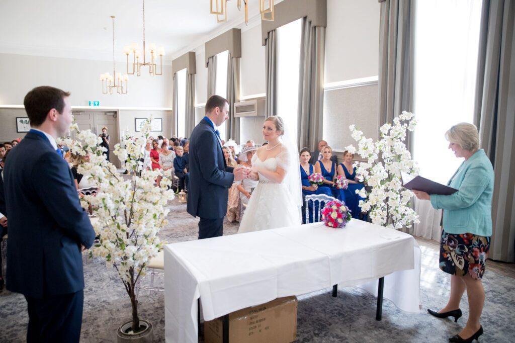 best man celebrant watch bride groom exchange rings de vere beaumont hotel windsor oxford wedding photographers