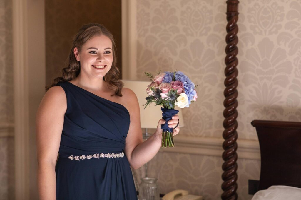 bridesmaid shows bouquet bridal prep hanbury manor ware hertfordshire oxford wedding photographer