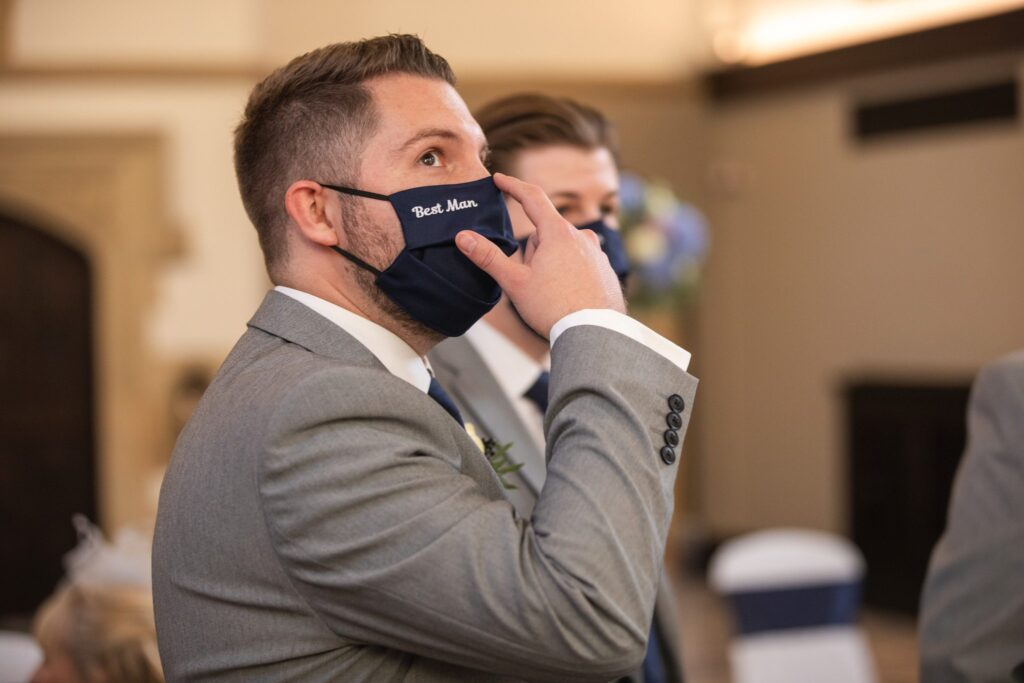 masked bestman awaits bride marriage ceremony hanbury manor ware hertfordshire oxford wedding photographers