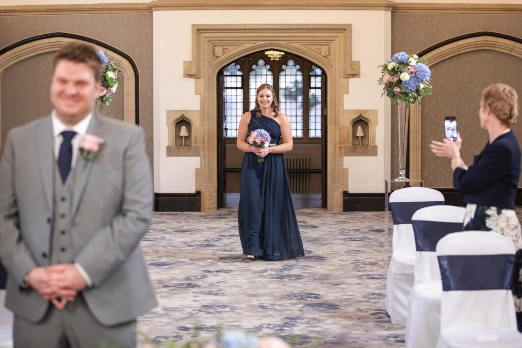 bridesmaid enters ceremony hanbury manor ware hertfordshire oxfordshire wedding photographer