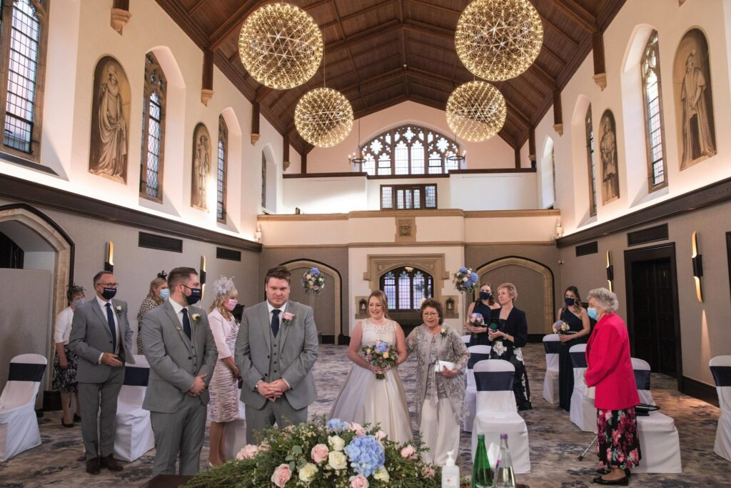 bride mother of bride approach groom marriage ceremony hanbury manor ware hertfordshire oxford wedding photographers