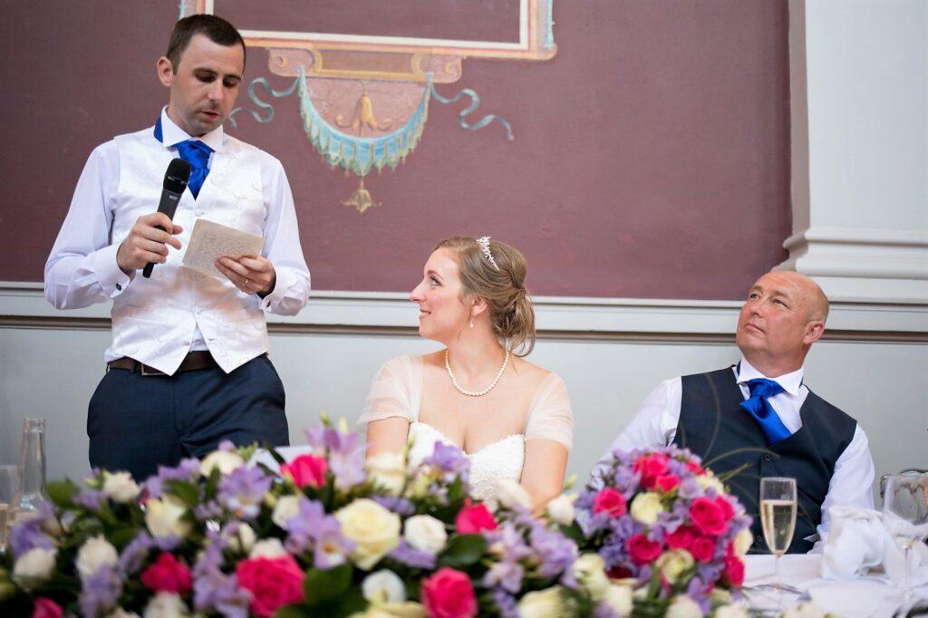 top table guests hear grooms speech de vere beaumont hotel windsor oxfordshire wedding photographer