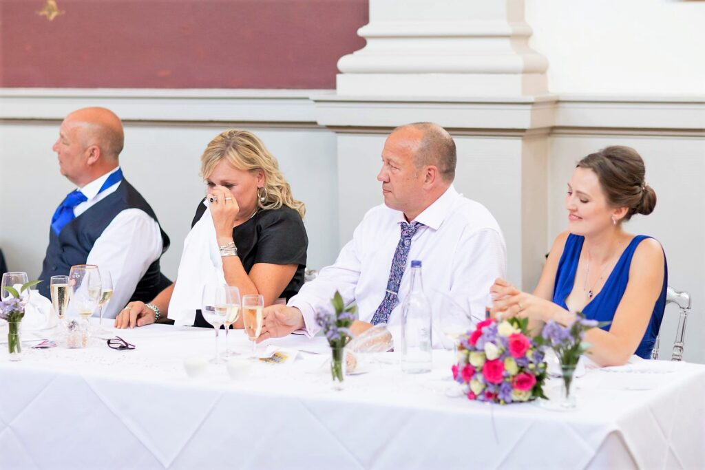 tearful top table guest hears grooms speech de vere beaumont estate windsor oxfordshire wedding photographers