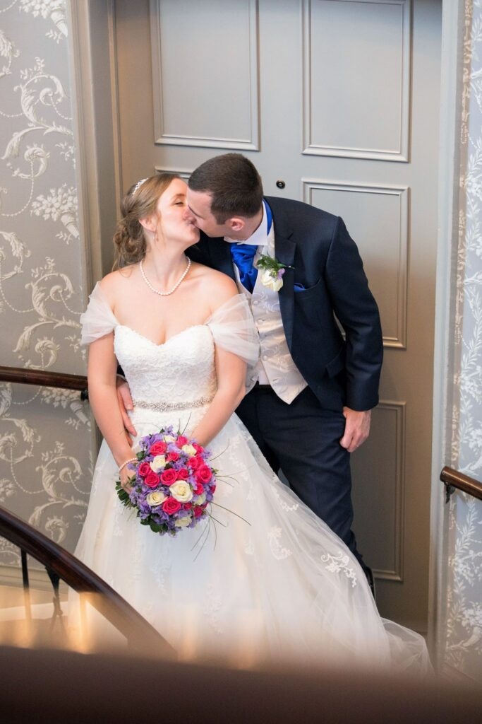 bride grooms staircase kiss de vere beaumont estate windsor oxford wedding photography