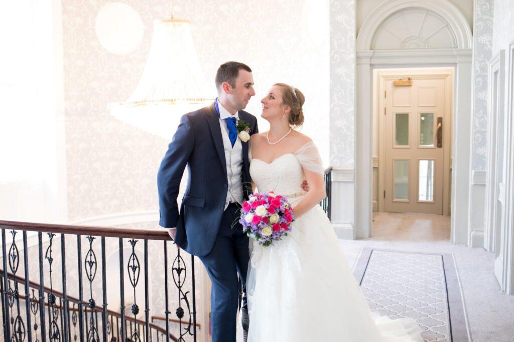 brides loving look de vere beaumont estate stairway windsor oxfordshire wedding photographer