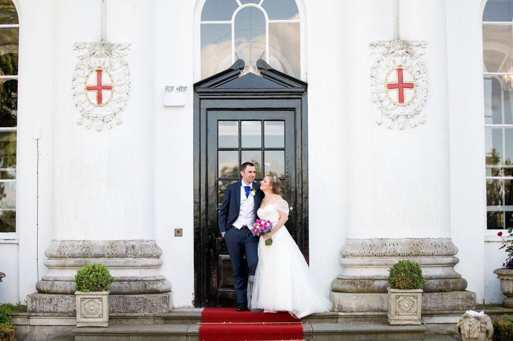 bride groom chapel doorway de vere beaumont estate windsor oxford wedding photographer