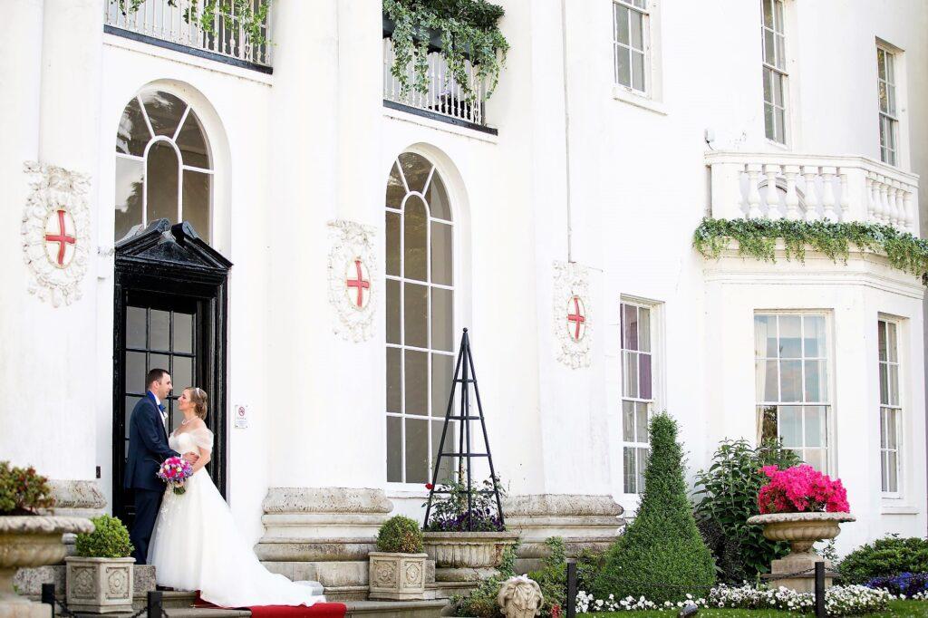 bride grooms formal portrait chapel doorway de vere beaumont estate windsor oxford wedding photographers