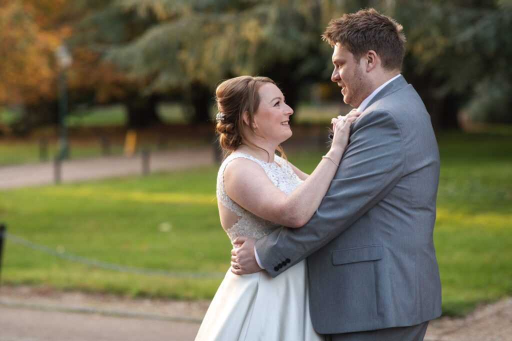 groom embraces bride hanbury manor grounds ware hertfordshire oxford wedding photographers