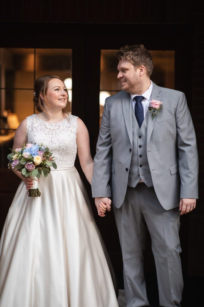 smiling bride groom hold hands hanbury manor archway ware hertfordshire oxford wedding photography