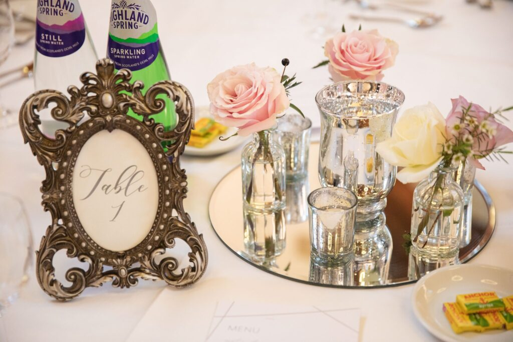 wedding breakfast table arrangement hanbury manor ware hertfordshire oxfordshire wedding photographers