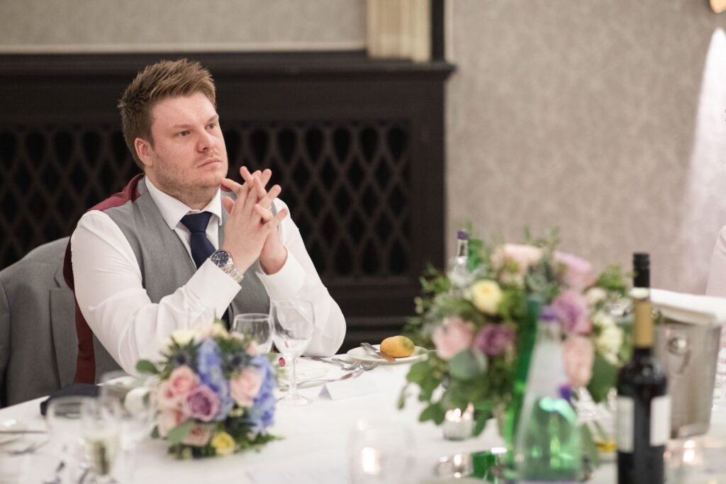 groom hears wedding breakfast speech hanbury manor ware hertfordshire oxford wedding photographer