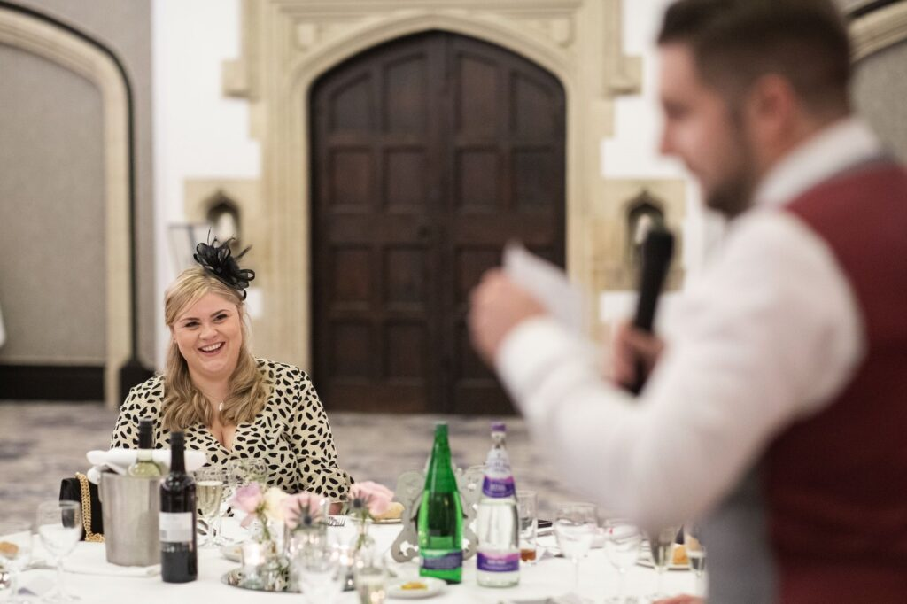 laughing guest hears bestmans speech hanbury manor ware hertfordshire oxford wedding photographers