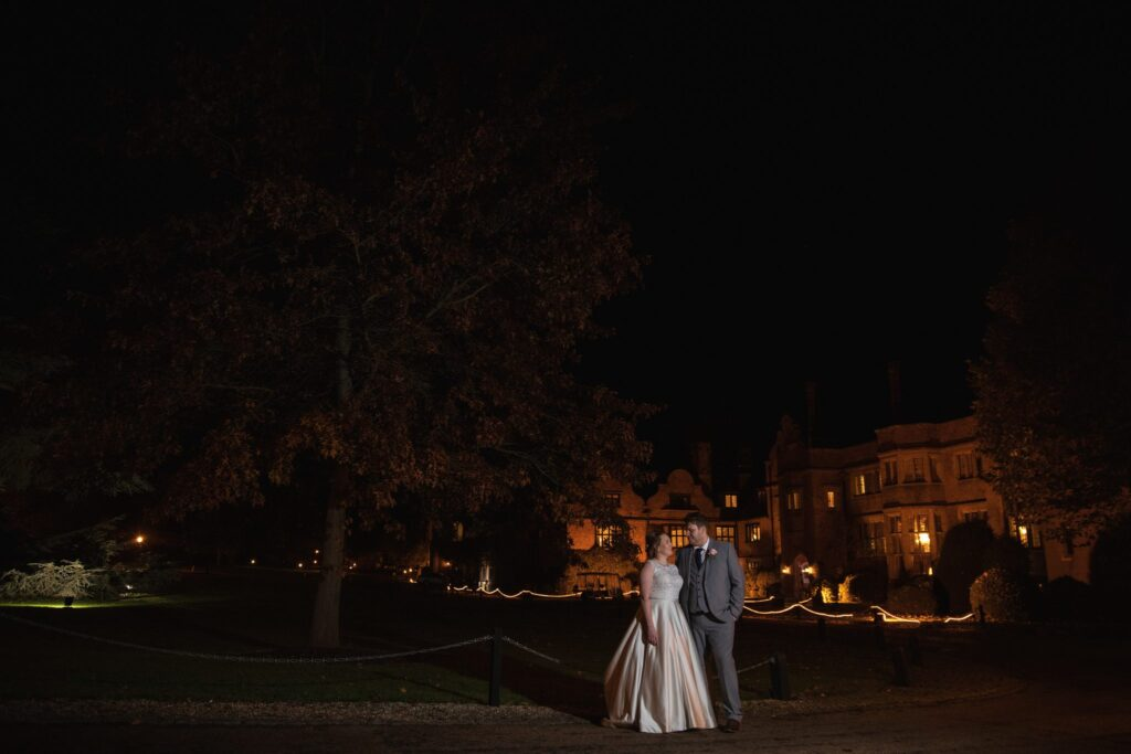 bride groom enjoy floodlit gardens hanbury manor ware hertfordshire oxford wedding photography