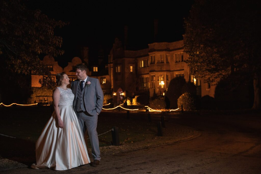 bride groom outside floodlit hanbury manor ware hertfordshire oxfordshire wedding photographers