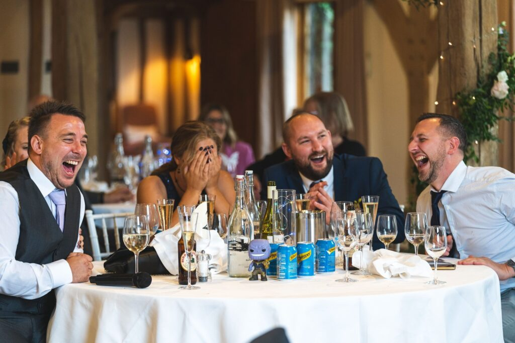 guests laugh loudly cain manor dinner reception hampshire oxford wedding photography
