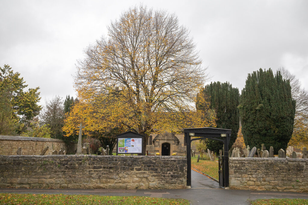churchyard gate st nicholas church ceremony old marston village oxfordshire wedding photography
