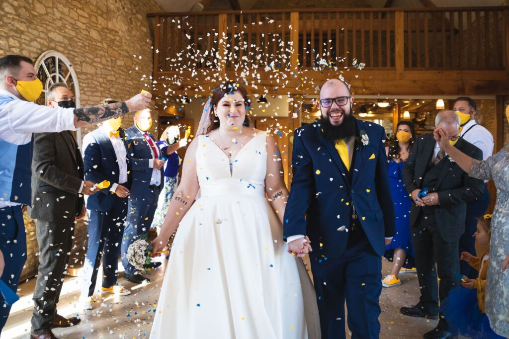 smiling bride groom confetti shower caswell house oxford wedding photographers