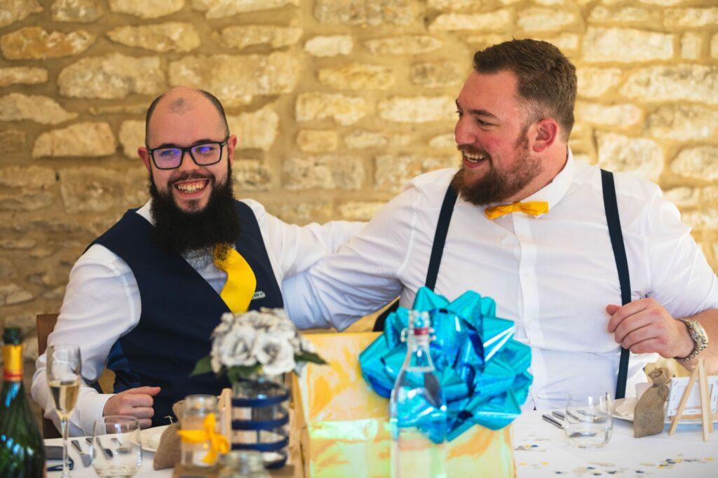 laughing groom bestman wedding breakfast caswell house oxfordshire wedding photographer