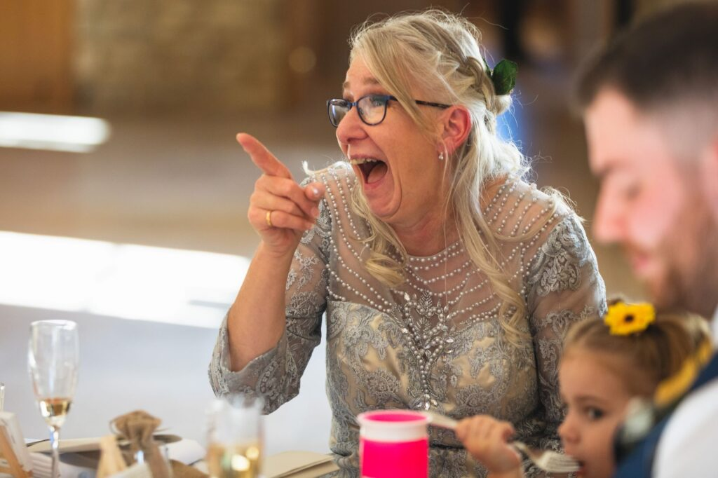 laughing mother of the bride wedding breakfast caswell house oxfordshire wedding photographers