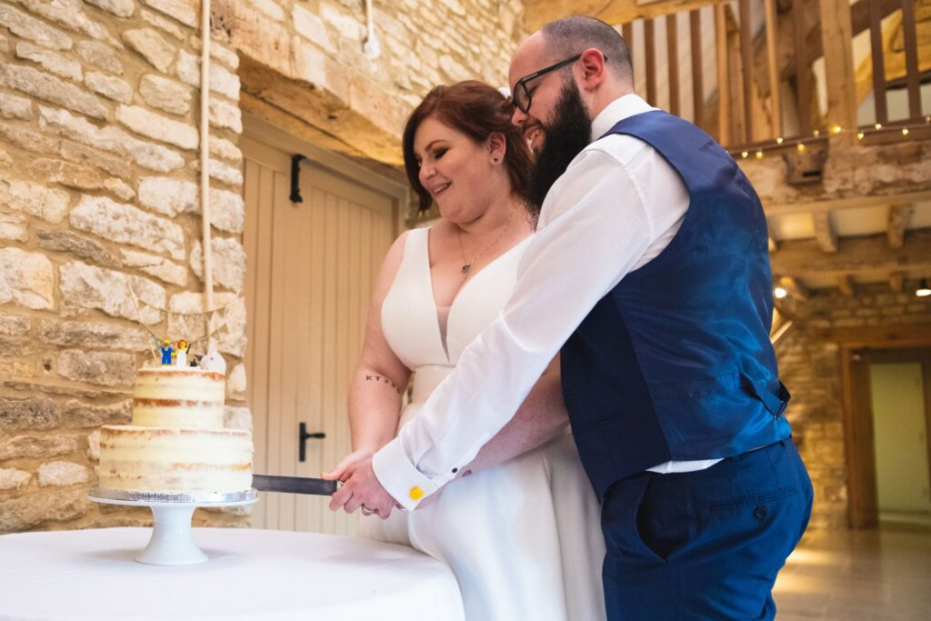 bride groom cut iced wedding cake caswell house venue oxford wedding photographers