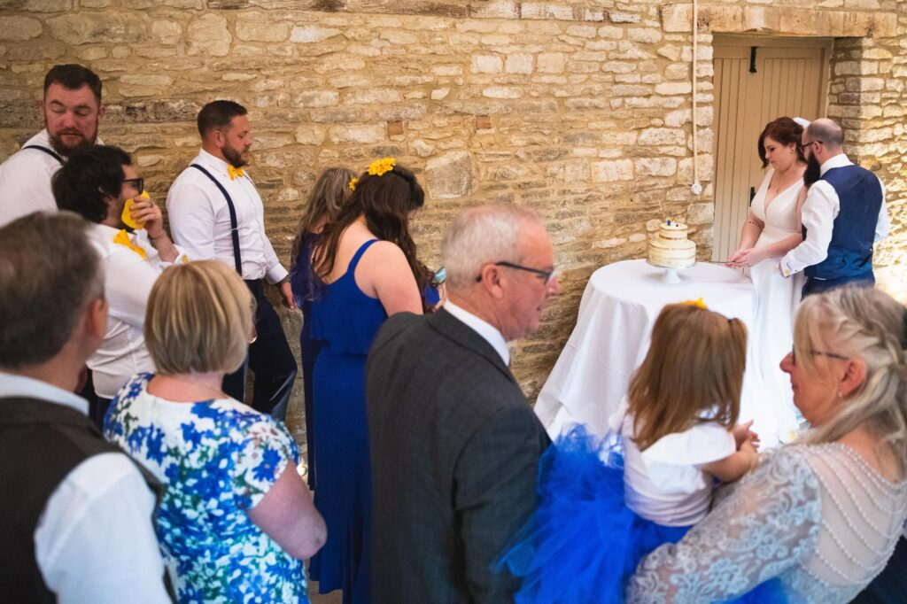 cake cutting ceremony caswell house venue oxfordshire wedding photography