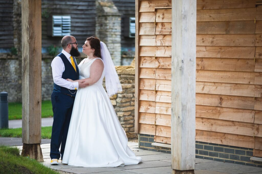 bride embraces groom caswell house venue oxford wedding photographer