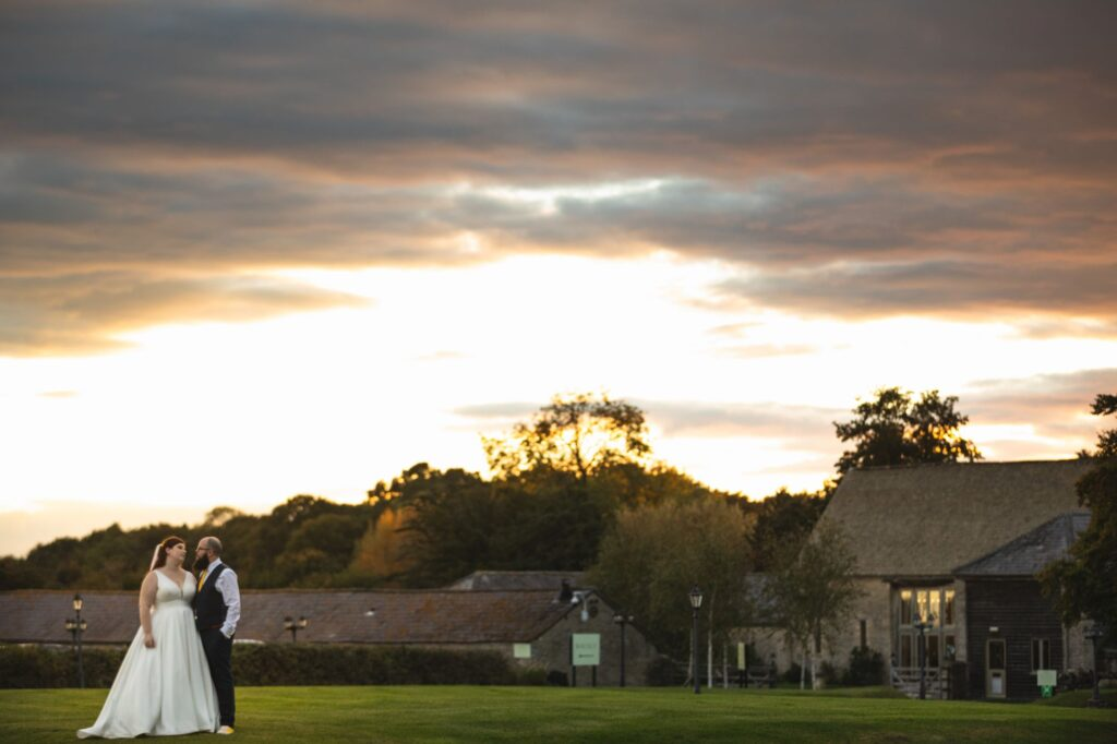 bride groom view sunset caswell house venue oxfordshire wedding photographer