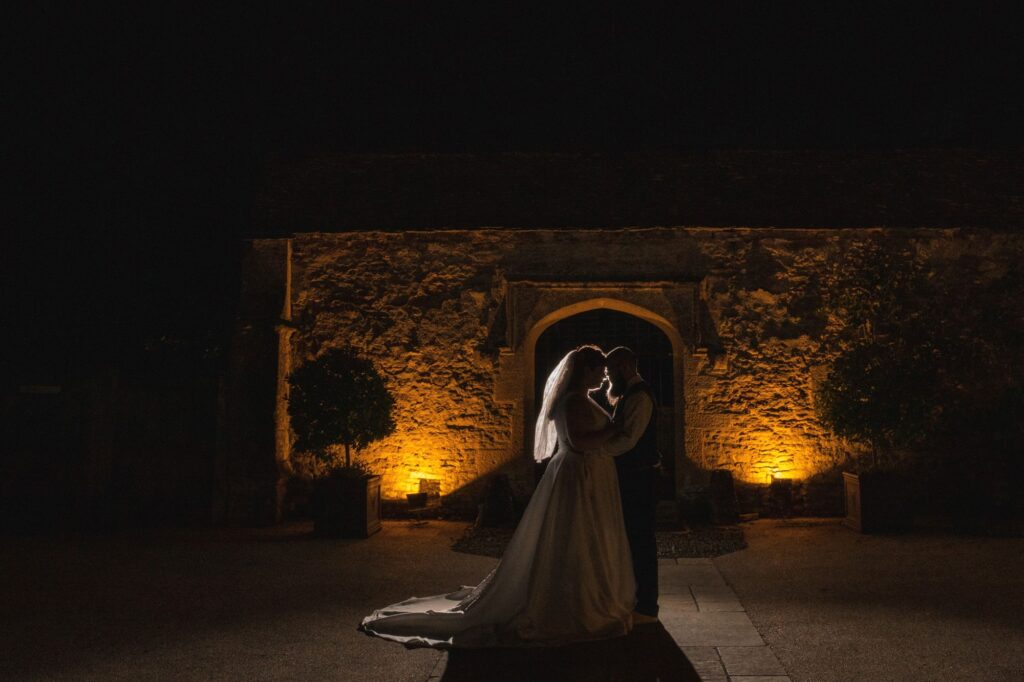 bride groom silhouette embrace caswell house venue oxfordshire wedding photographers