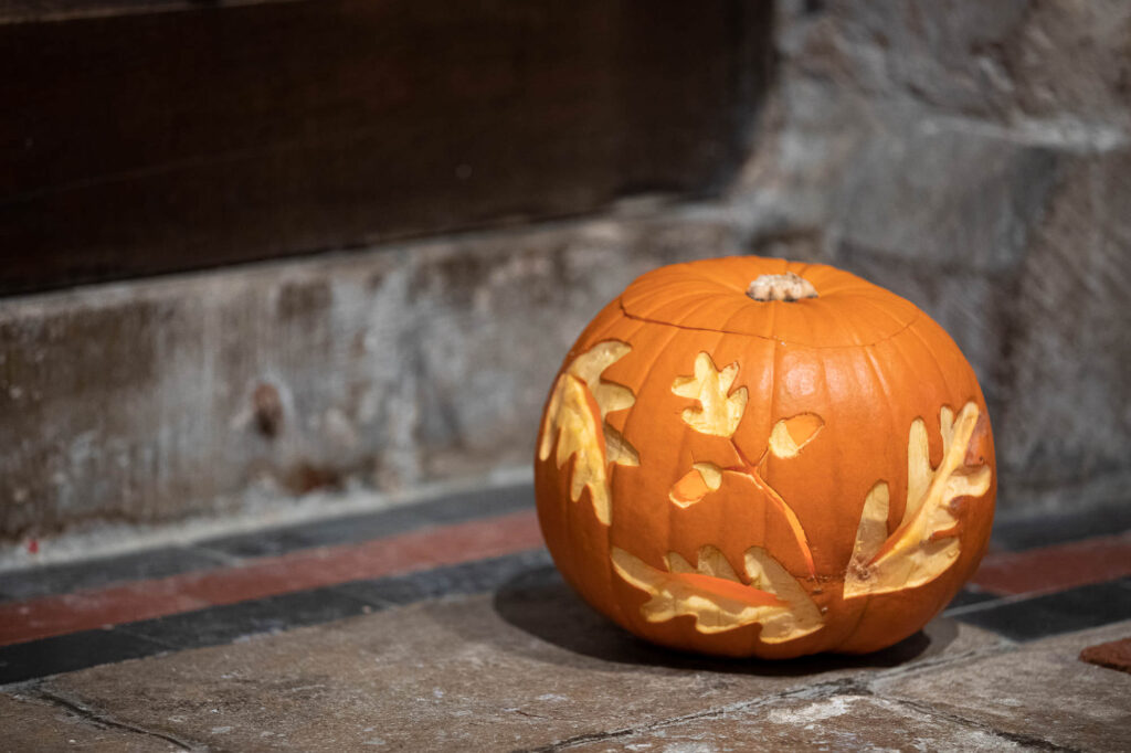 candlelit carved pumpkin st nicholas church old marston oxford wedding photography