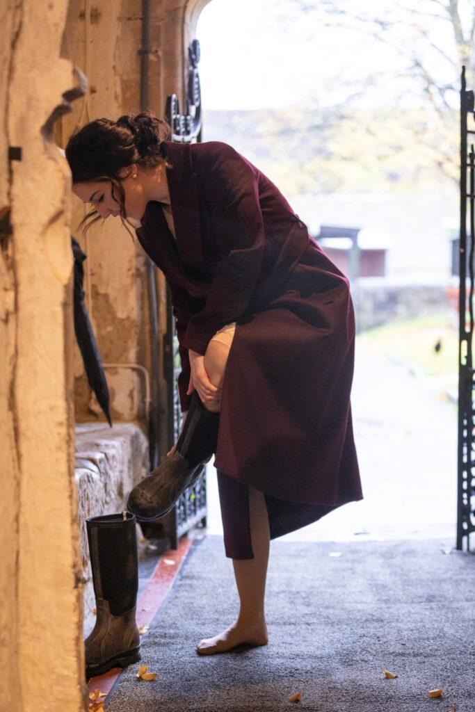 bride changes wellies church doorway st nicholas old marston oxfordshire wedding photographers