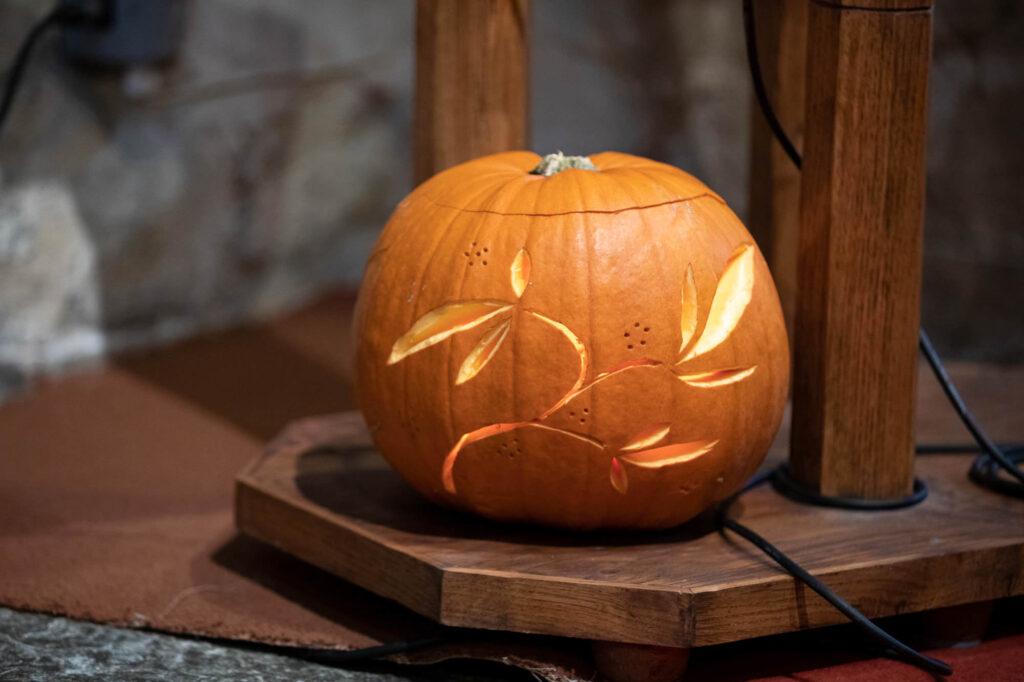 carved candlelit pumpkin ceremony decoration st nicholas church old marston oxfordshire wedding photography